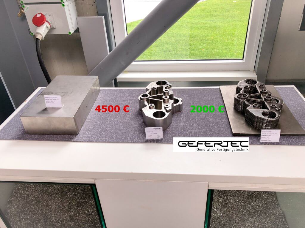 Gefertec's 3D metal printers are able to make near-net-shape parts that require only a small amount of machining. In the example in the picture, the 3D metal printed titanium part cost only € 2,000 compared to the traditional machined part of € 4,500.