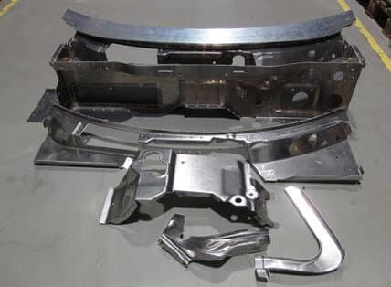 Öljytön Irmco metallinmuovausaine mahdollisti alumiinisten auton rungon osien valmistamisen, vaikka vetomuokkaus-simulaation mukaan osan niistä piti olla periaatteessa mahdottomia toteuttaa.